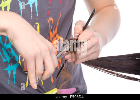 Young woman having a hair cut - Stock Photo