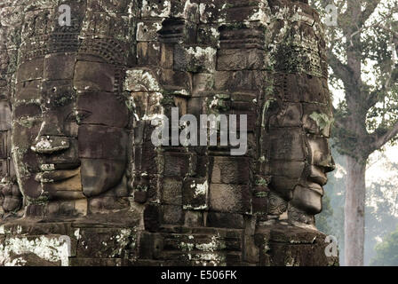 The faces of the Bayon temple. Angkor Thom. We stand before it stunned. It is like nothing else in the land. The - Stock Photo