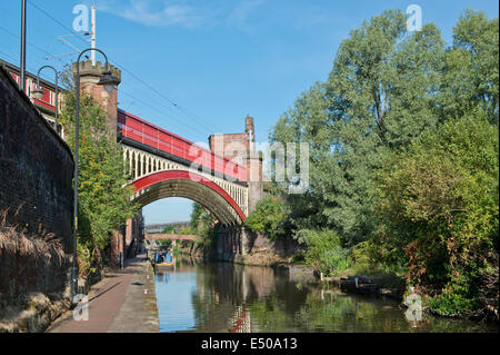 The Castlefield Urban Heritage Park and historic inner city canal conservation area including railway bridge in - Stock Photo