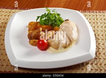 Roast chicken with potatoes - Stock Photo