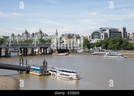 River Thames looking towards Festival Pier and Charing Cross station on the Embankment from Waterloo Bridge London - Stock Photo