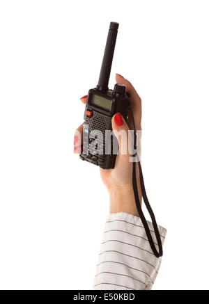 walkie-talkie in womans hand - Stock Photo
