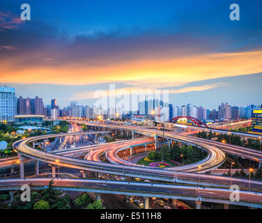 city interchange overpass in sunset - Stock Photo