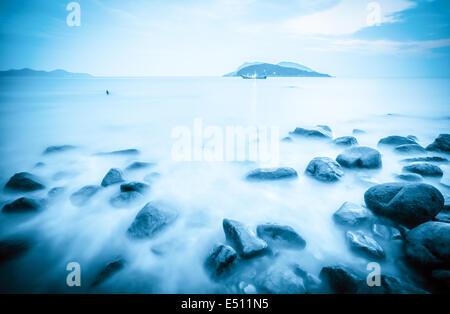 rocks in surf of fantastic seascape - Stock Photo