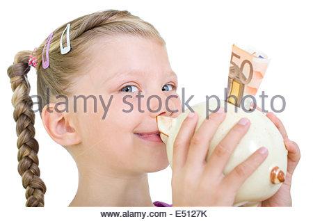 Girl kissing piggy bank - Stock Photo