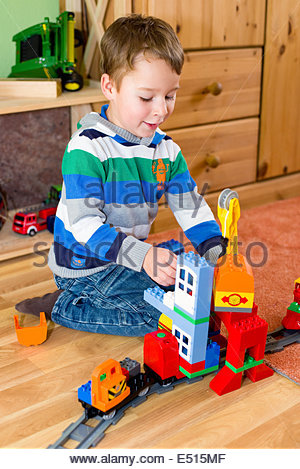 Little boy playing with Lego Duplo - Stock Photo