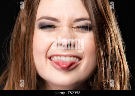 Grimacing. Young Woman Making Silly Face. - Stock Photo