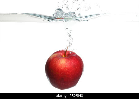 red apple in the water splash over white - Stock Photo