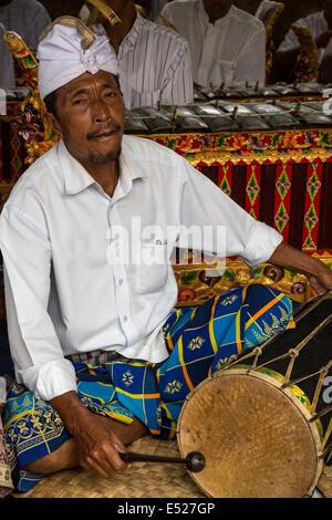 Jatiluwih, Bali, Indonesia.  Drummer in a Gamelan Orchestra,  Luhur Bhujangga Waisnawa Hindu Temple. - Stock Photo