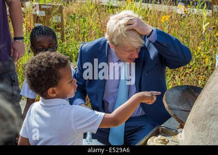 London, UK. 18th July, 2014. The London Mayor Boris Johnson meets with pupils, parents and teachers at Christ Church - Stock Photo