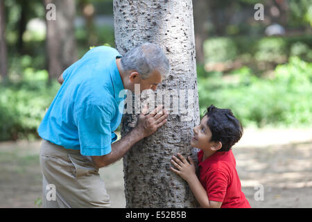 Grandfather and grandson playing hide and seek - Stock Photo