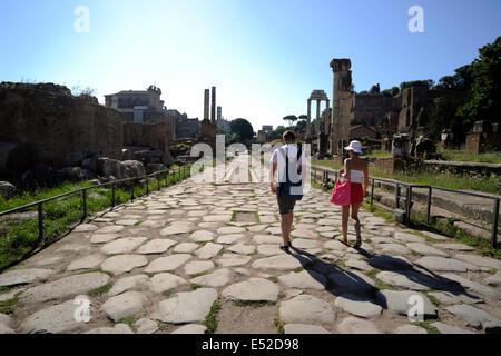 italy, rome, roman forum, tourists walking along the via sacra (sacred street) - Stock Photo