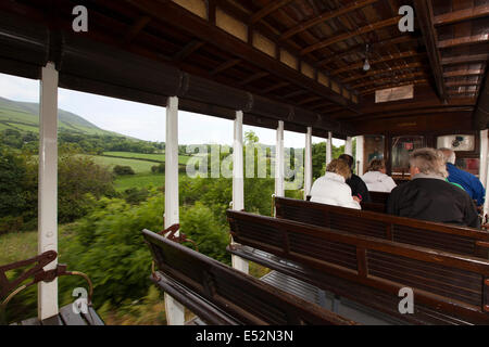 Isle of Man, Manx Electric Railway, passengers in open car at North Barrule - Stock Photo