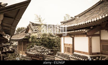 Traditional Korean architecture in Bukchon Hanok Village in Seoul, South Korea. - Stock Photo