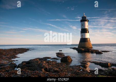Autumn sunrise at Penmon Lighthouse, Anglesey Wales UK - Stock Photo