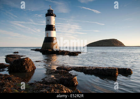 Autumn sunrise at Penmon Lighthouse, Anglesey Wales UK - Stock Photo