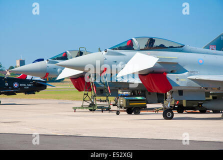 The noses of two Eurofighter Typhoon FGR4 aircraft (parked) with canards angled down and intake covers in place - Stock Photo