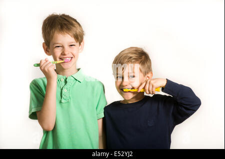 young brothers brushing teeth - Stock Photo