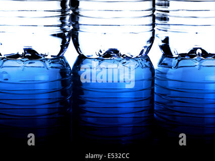 Three bottles of water with reflection - Stock Photo
