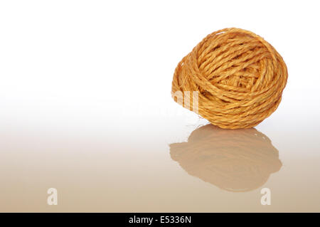 Ball of sisal cord with reflection - Stock Photo