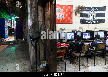Children playing video games at a web cafe in Old Cairo, Egypt - Stock Photo