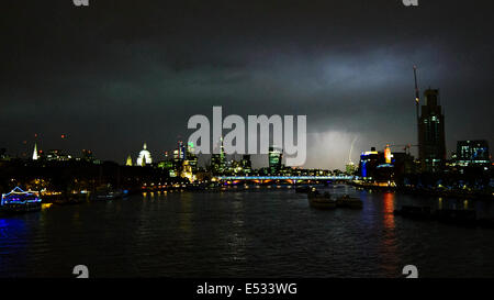London, UK. 18th July, 2014. Lightning Strikes over London, view from Waterloo bridge towards Canary Wharf at 10pm. - Stock Photo