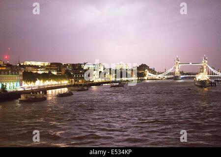 London UK 18th July 2014.Stormy weather over East London, Lightning over Tower Bridge skyline - Stock Photo