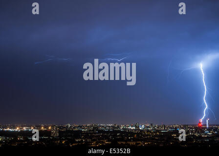 London, UK. 18th July, 2014. Lightning and stormy weather created a light show over London late Friday night. Mixed - Stock Photo
