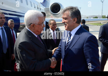 Istanbul, Turkey. 18th July, 2014. Palestinian President Mahmoud Abbas (L) shakes hands with Turkish President Abdullah - Stock Photo