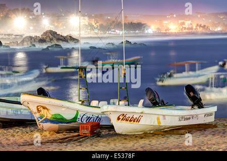 Fishing boats at twilight on the Playa Municipal of Puerto Escondido, Oaxaca, Mexico. - Stock Photo