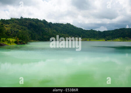 Volcanic, water-filled crater, Lake Linow in Indonesia - Stock Photo