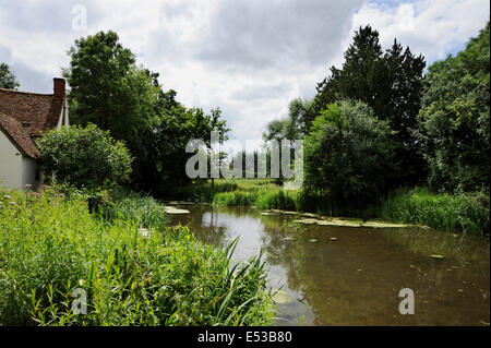 This is the famous view which formed Constable's most famous painting The Hay Wain at Flatford Mill Suffolk UK - Stock Photo
