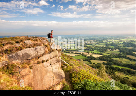 A Rambler looking across the Cheshire Plains from Bosley Cloud, Congleton, Cheshire. UK - Stock Photo