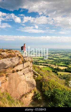 Rambler looking across the Cheshire Plains from Bosley Cloud Near Congleton, Cheshire UK - Stock Photo