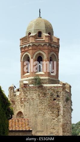 tower of the San Giovanni Battista Church in Castiglione della Pescaia, Tuscany, Italy - Stock Photo
