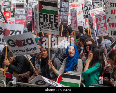 London, UK. 19th July, 2014.  Pro-Palestinian activists protest outside the Downing Street against the Israeli Defence - Stock Photo