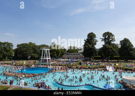crowded outdoor swimming pool full of people bathing in germany on a stock photo 71997767 alamy. Black Bedroom Furniture Sets. Home Design Ideas