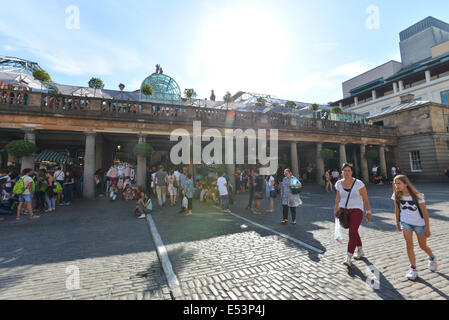 Covent Garden, London, UK. 19th July 2014. Londoners and tourists enjoy the sunshine  in Covent Garden Credit:  - Stock Photo