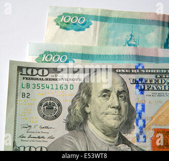 One Hundred Dollar and Russian Rubles - Stock Photo