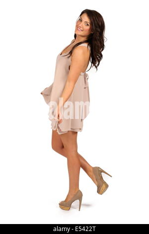 Studio shoot using female model with dark hair against a white background. - Stock Photo