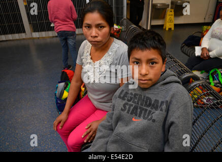 A Guatemalan woman and her son, who crossed illegally from Mexico into the USA, wait at a bus station in Tucson, - Stock Photo