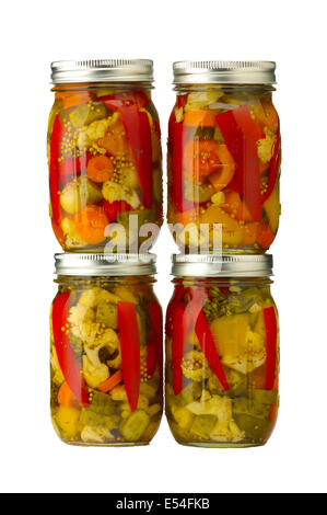 Four jars of pickled vegetables isolated - Stock Photo