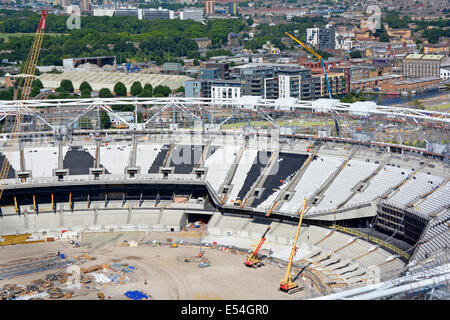 London Olympic stadium being converted for use by West Ham United Football Club and British Athletics - Stock Photo