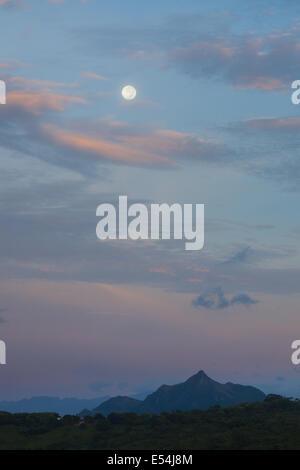Moon over Cerro Orari, 560 m, near La Pintada in the Coclé province, Cordillera Central, Republic of Panama. - Stock Photo