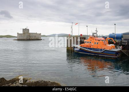 Barra lifeboat and Kisimul Castle in Castlebay, Hebrides, Scotland, UK - Stock Photo