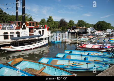 Boats for hire alongside River Thames at Henley on Thames Oxfordshire UK - Stock Photo