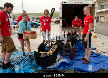 Illinois State University members survey the remains of their car that burned in an overnight electrical fire prior - Stock Photo