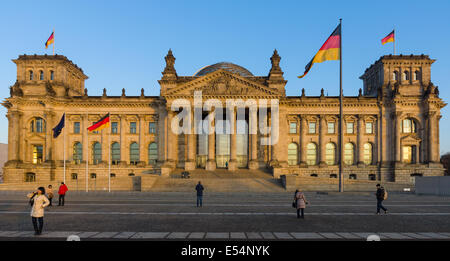 BERLIN, GERMANY - FEBRUARY 04, 2014: The Reichstag building at sunset. The Reichstag building is a historical edifice - Stock Photo