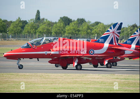 The Red Arrows Hawk jets prepare for takeoff at the Farnborough International Airshow 2014 - Stock Photo