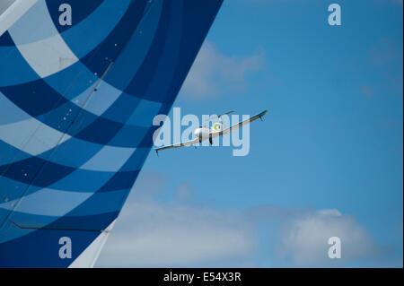 Airbus Industries largest and smallest aircraft, A380 tailfin and the Electric E Fan, Farnborough International - Stock Photo